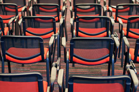Red and black conference chairs in the auditorium