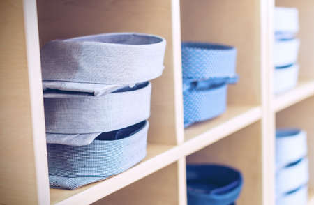 Blue mens shirts on shelves at a retail store