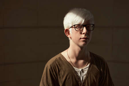 Portrait of european albino boy wearing glasses 免版税图像