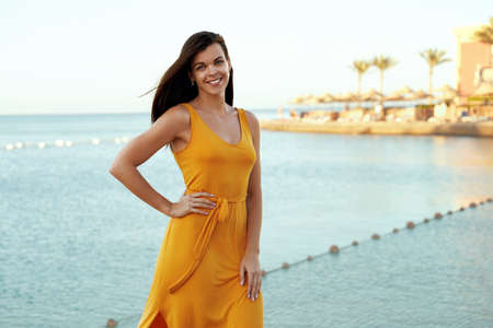Happy european girl posing on tropical seafront 免版税图像