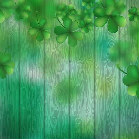 St Patricks Day shamrocks over a green wood background.
