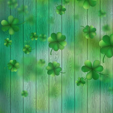 St Patrick Tagesshamrocks über einem grünen hölzernen Hintergrund.