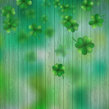 St Patricks Day shamrocks over a green wood background.