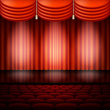 Spotlight on stage and red curtain.