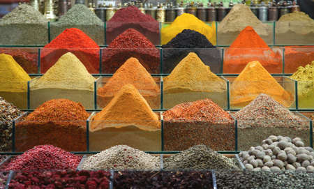 Traditional colorful turkish spices in the bazaar. Shot made in the Spice market in Istanbul, Turkey photo