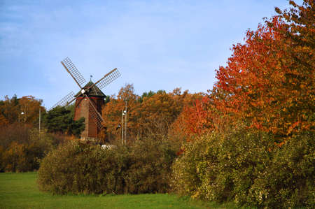 Retro windmill in the autumn forest. Shot in Stockholm, Sweden. Focus on a windmill photo