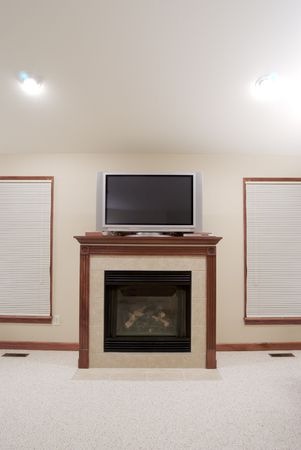 wood blinds: Fireplace and Flat Screen TV