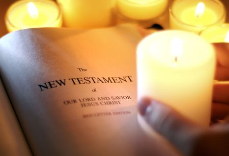burning paper: New Testament by Candlelight Stock Photo