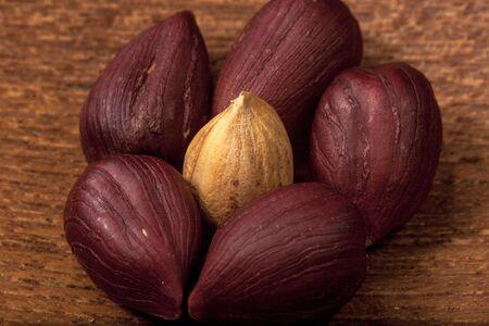 Hazelnuts, macro on a wooden background