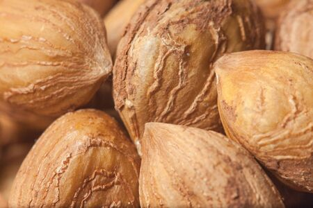 Hazelnut Background. Heap of peeled hazelnuts