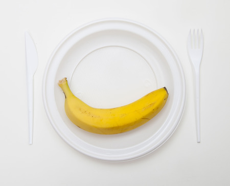 White disposable dishware set Fork, Knife and Banana