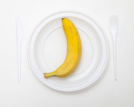 White disposable dishware set Fork, Knife and Banana
