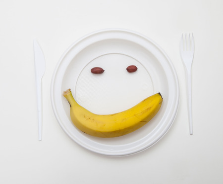 White disposable dishware set Fork, Knife, Peanut and Banana