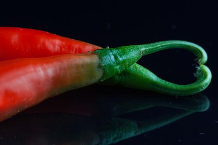 Pepper paprika isolated on black Banco de Imagens