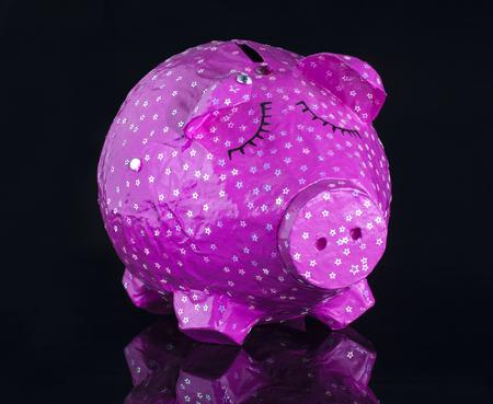 Hand made Piggy bank on black background Banco de Imagens