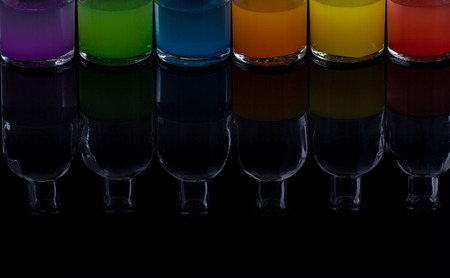 Apothecary bottles with colored liquid with reflection Banco de Imagens