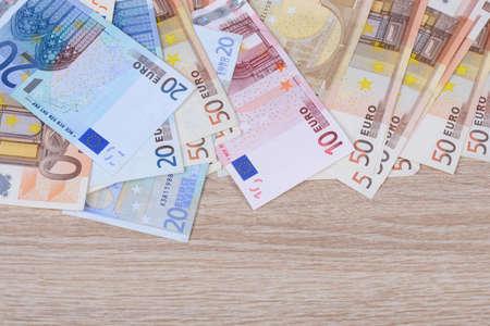 financially: Euros on wood Stock Photo