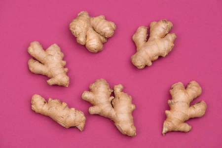 Fresh ginger roots, empty copy space for text.