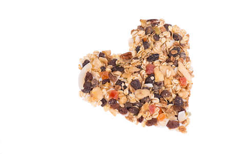 Muesli with otas, nuts and fruits isolated on a white background