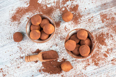 Marzipan potatoes, in german called Marzipankartoffeln, with cacao powder, sweets for christmas, empty copy space