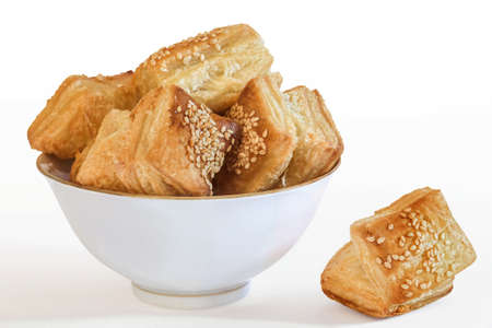 Square puff croissant pastry Zu-Zu in white porcelain bowl, isolated on white background, and supplied with precise photo