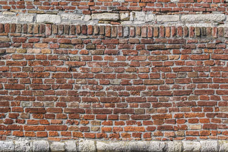 Antique brick and stone medieval fortress rampart detail  photo