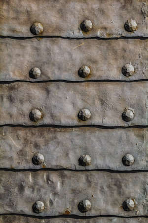 Medieval fortress metal armored gate entrance door detail photo