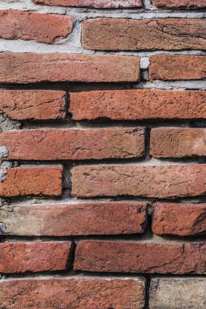 Photograph of old, repaired red brick wall detail  photo