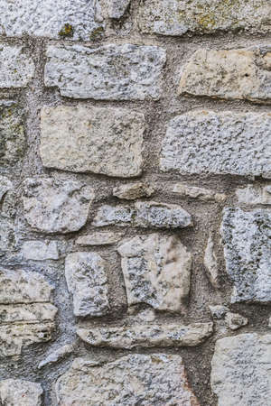 stone cutter: Photograph of old medieval fortress carved-stone rampart, detail