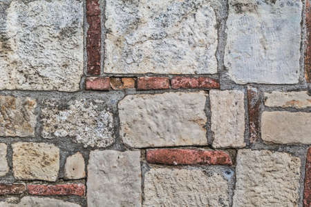 stone cutter: Photograph of old medieval fortress rampart, made of carved stone and red brick, detail  Stock Photo