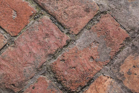 Photograph of old medieval red brick pavement pattern - detail  photo