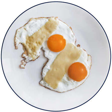 Photograph of pair of fried sunny side up eggs, on white plate, isolated on white background, and supplied with precise clipping path  photo