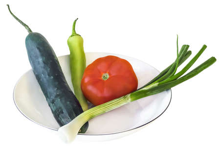 Spring Vegetables In White Plate - Cucumber, Cayenne Pepper, Tomato And Spring Onion  photo
