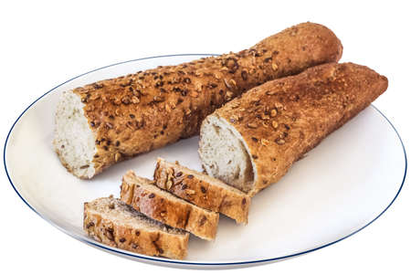 Photograph of baguette integral bread cut in slices on white plate  The image is isolated on white, and supported with clipping path  photo