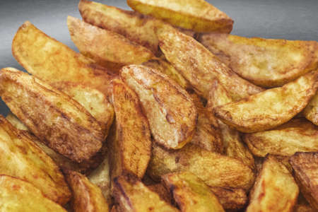 Photograph of fried potato slices in Teflon frying pan - detail  photo