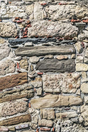 Photograph of old medieval fortress stone-brick rampart - detail  photo