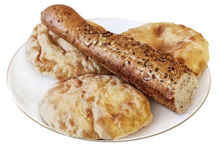 Photograph of three pita bread loafs and integral baguette half  on top, in porcelain white plate   photo