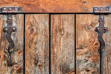 an antique rustic Pine wood door with wrought iron hinges - detail  photo