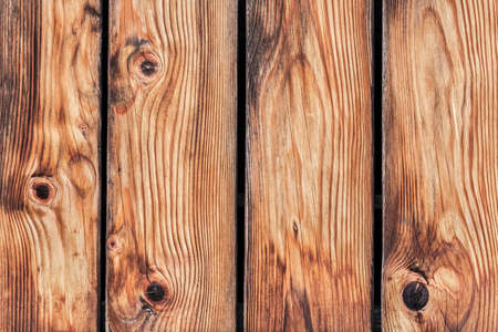 interstice: Photograph of an old rustic Pine wood fence - detail
