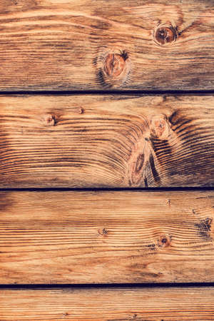 Photograph of an old rustic Pine wood fence - detail  photo
