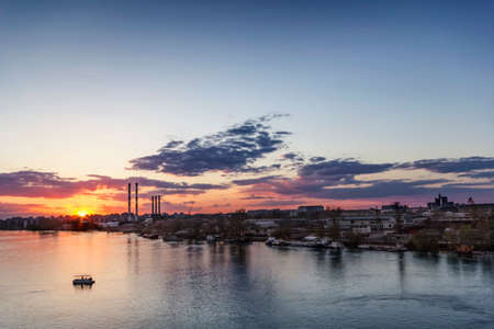 Panoramic photograph of cloudy sunset skies on Sava river left bank, the New Belgrade side - Belgrade - Republic of Serbia  photo