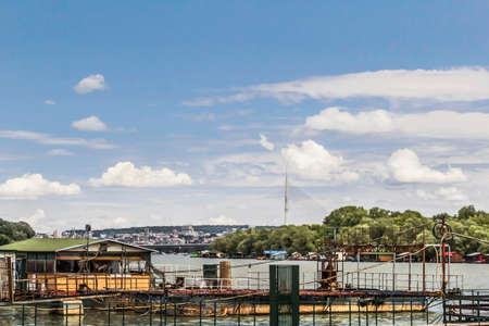 Belgrade panoramic photograph with blue skies and fluffy white clouds, Sava river and Bridge over Ada pylon  photo