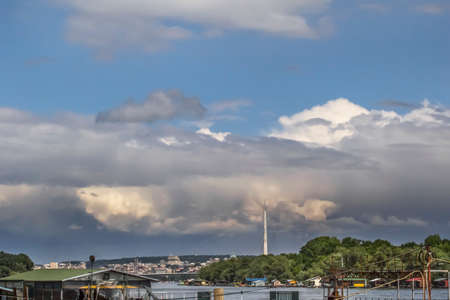 cloudy Belgrade skyline with Sava river and the Bridge over Ada pylon, with storm approaching on the horizon   photo