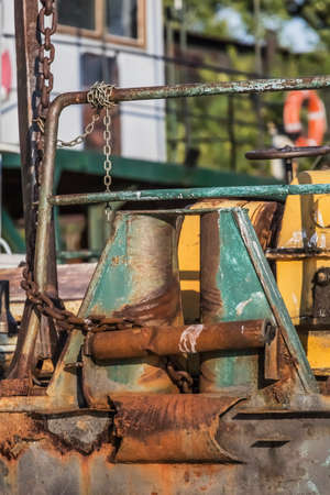 Photograph of abandoned barge, anchor chain winch capstan detail, at the ship winter shelter and shipyard anchorage on Sava river - Belgrade - Serbia Stock Photo - 23245919
