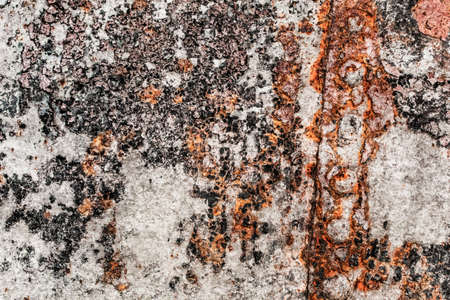 entropy: Very old, obsolete, badly corroded rusty metal plates, connected with rivets, covered with cracked, decomposed layers of paint, tar and rust  Stock Photo