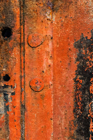 entropy: Old, obsolete, badly corroded rusty metal plate, covered with cracked, decomposed layers of cracked, decomposed paint and rust