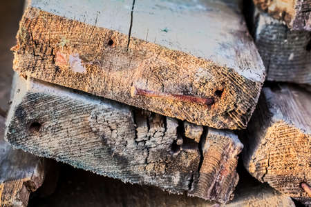 disposed: Old, rotten, wasted decking planks heap - profile view