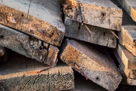Old, rotten, wasted decking planks heap, with bent, rusty nails embedded - profile view  photo