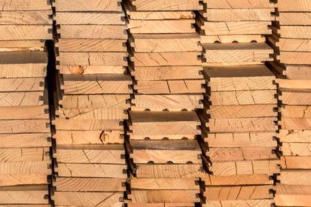 White Pine decking planks heap - profile view  photo