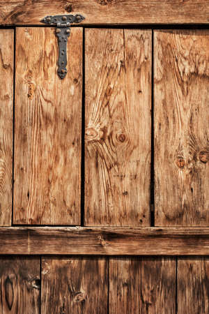 interstice: Photograph of old, weathered rustic Pine wooden door, with wrought iron hinges - detail  Stock Photo